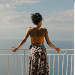 busy woman looking out over balcony