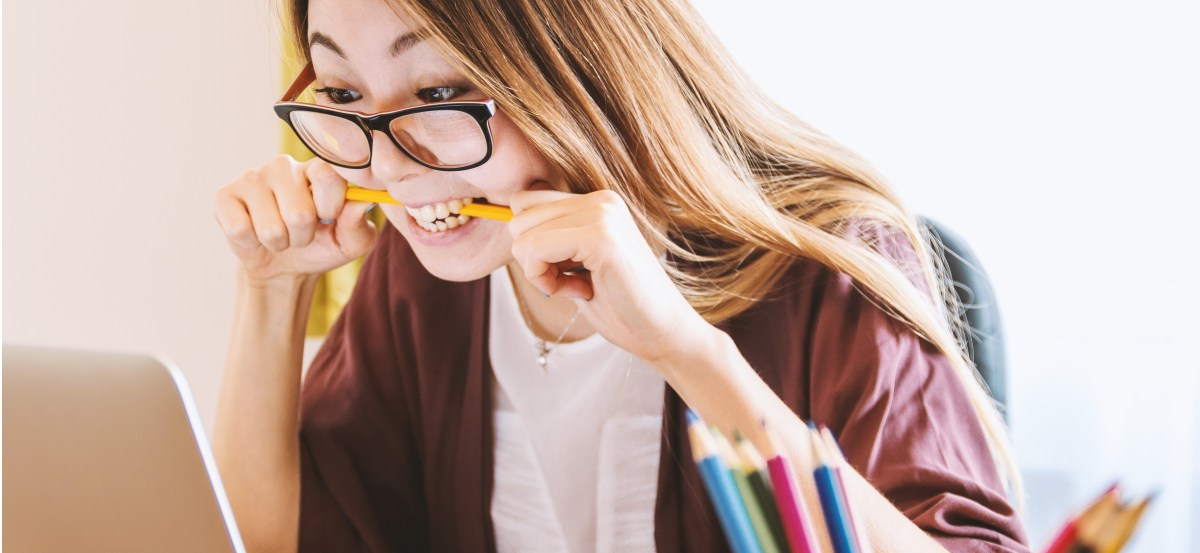 how to know if you should leave your career, frustrated girl biting pencil