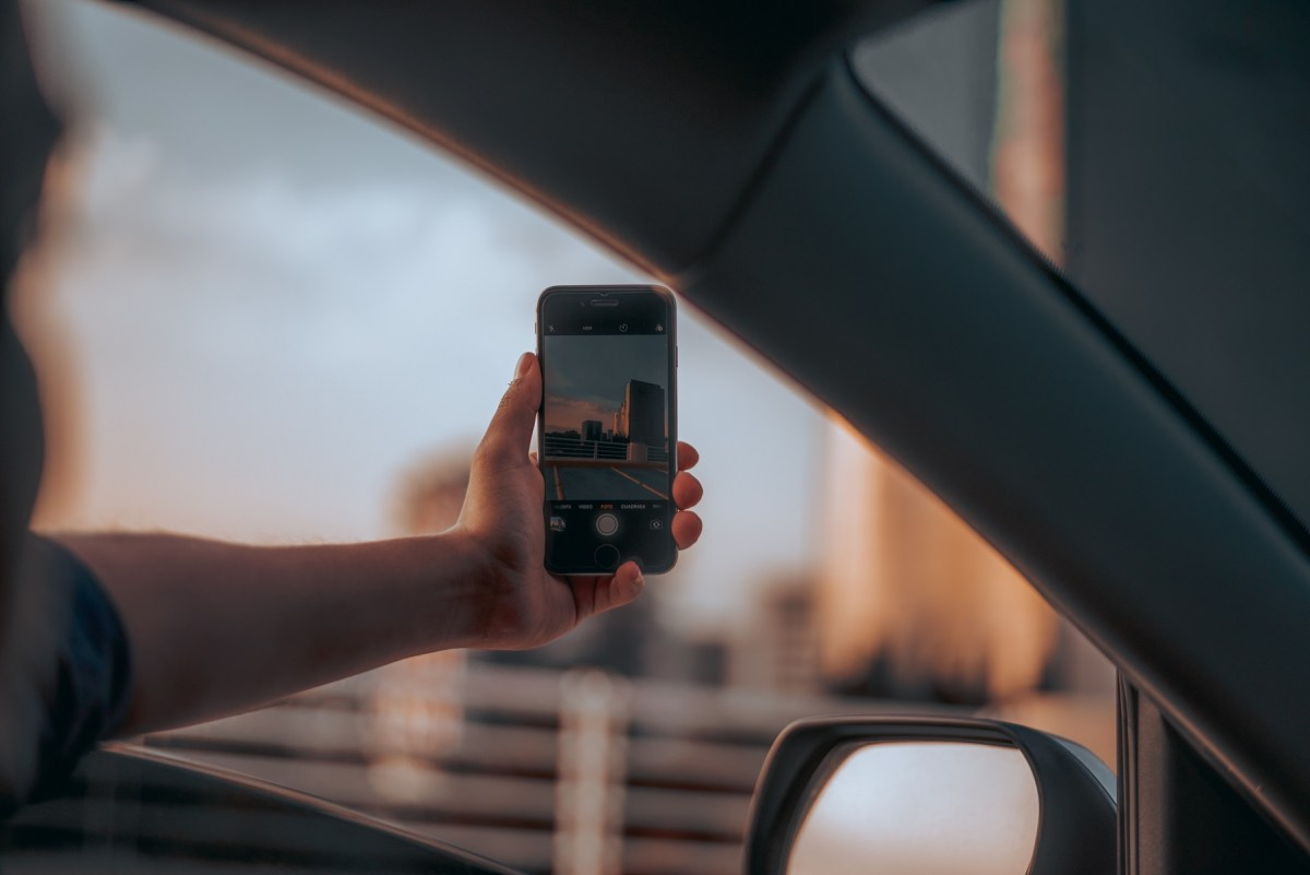 person holding phone out window, social media hacks