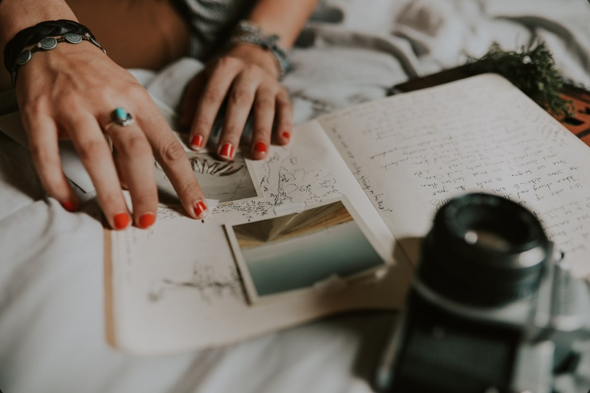 person with pictures and notebook, creative writing prompts