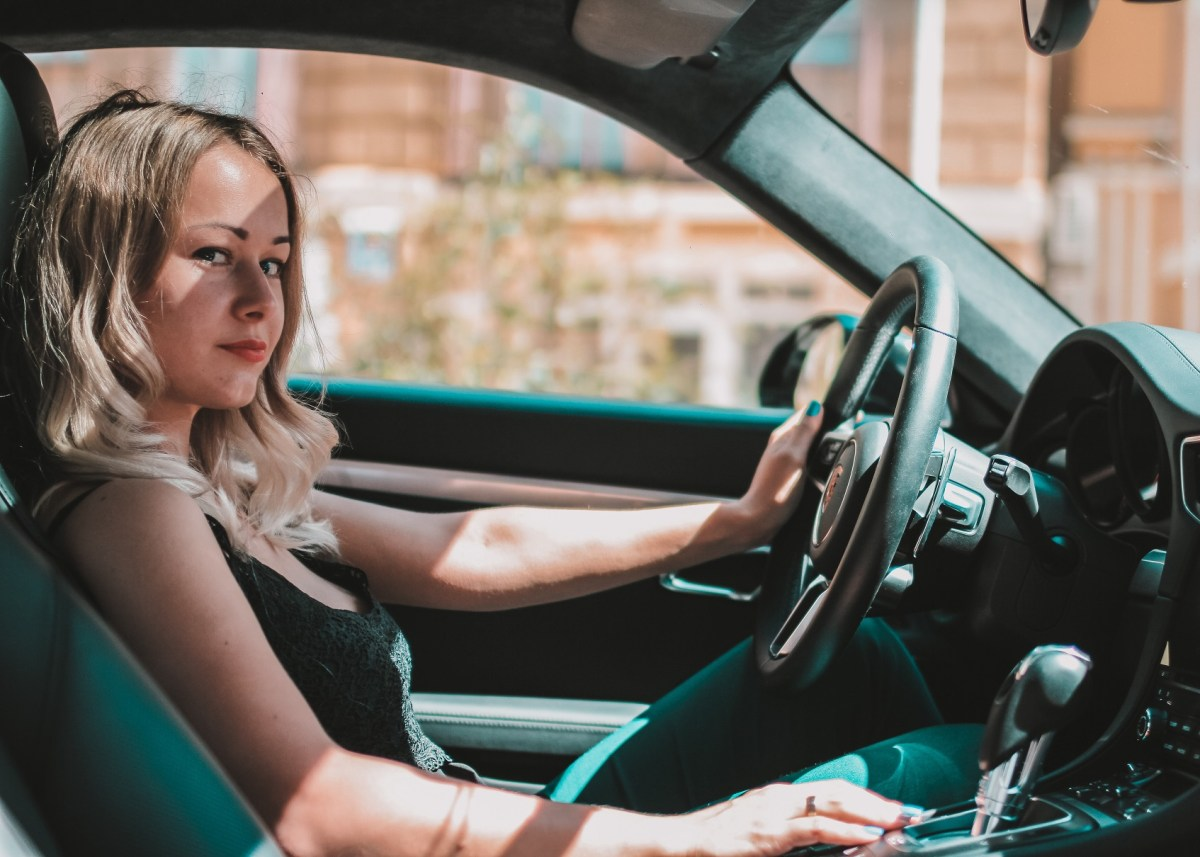 happy girl driving tips for lessening your load